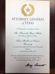 Texas Attorney General Greg Abbott presents THSU with a Community Partnership Award.